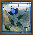 Blue tulip is a stained glass artwork; click for enlargement and details.